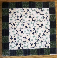 A completed geometric mosaic.