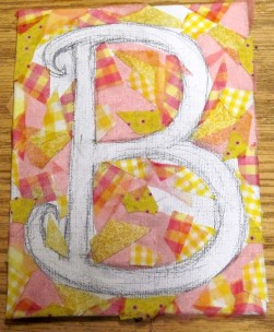 A pictorial mosaic in progress; letters provide an easy design to practice on.
